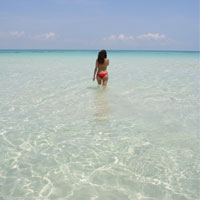 walking in the water of north beach in isla mujeres